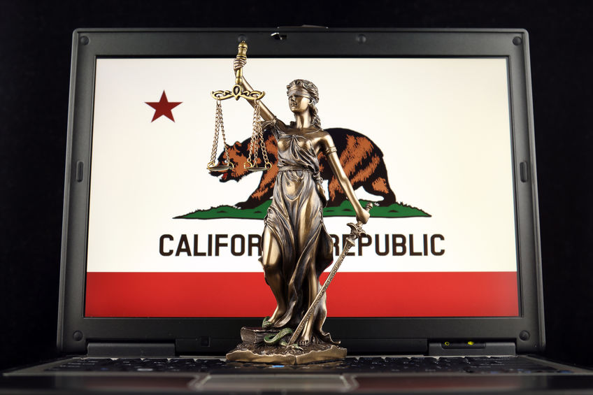 symbol of law and justice on laptop for California law