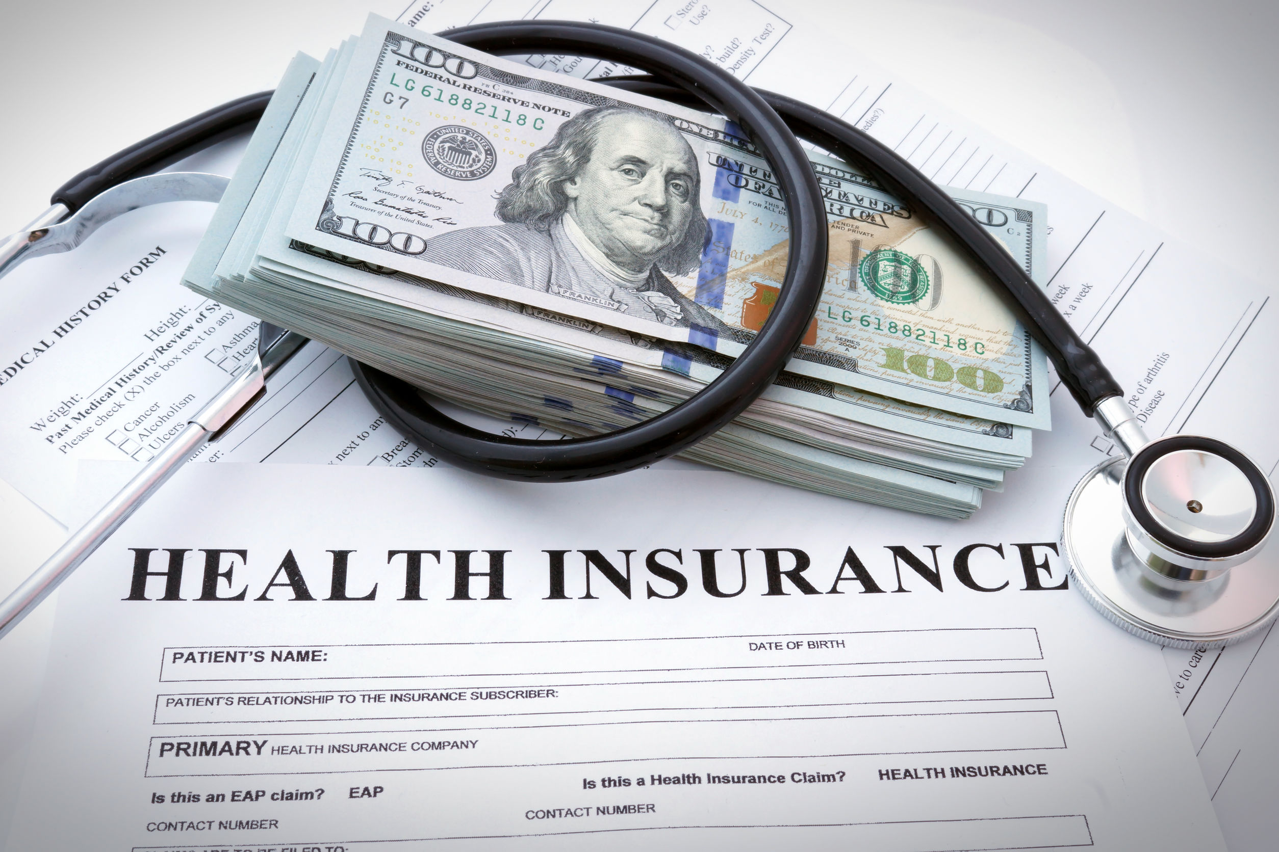 Tax money on top of insurance papers