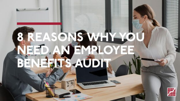 8 Reasons Why you Need An Employee Benefits Audit. Woman in office handing a document to an employee.